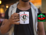 """UNIVERSITÉ KAMITE NGUZO SABA 47"" by A-FREE-CAN.COM - (2 Mugs par lot)"